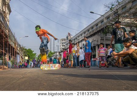 KOLKATA WEST BENGAL INDIA - JANUARY 3RD 2015 : Unidentified city children rollerskating - jumping freezed mid air Park Street for