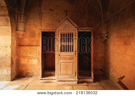 ORADOUR SUR GLANE FRANCE - December 03 2017 : inside the church where were burned women and children during the massacre of the population by the Nazis on June 10 1944 the wooden confessional retained almost intact since that time