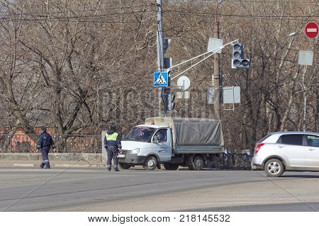 Nizhny Novgorod, Russia. - March 14.2017. Employees of the State Traffic Safety Inspectorate inspect cars in Lenin Square. The policeman chooses which car to stop for inspection.