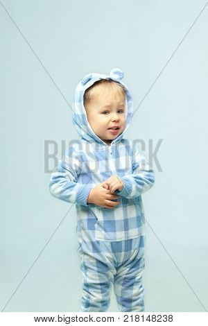 Cute Little Baby Boy.People, children, childhood concept - Cute little baby boy wearing on sleepwear standing  in the room, cropped shot.