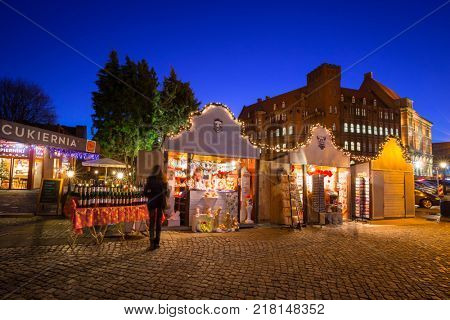 GDANSK, POLAND - DECEMBER 8, 2017: Traditional Christmas fair in the old town of Gdansk, Poland. Gdansk is the historical capital of Polish Pomerania with gothic architecture.