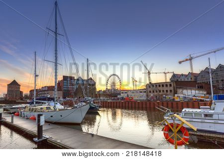 GDANSK, POLAND - DECEMBER 8, 2017: Winter sunset at Motlawa river and marina in Gdansk, Poland. Gdansk is the historical capital of Polish Pomerania.