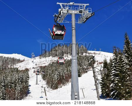 Jasna Slovakia - December 1 2017: View of the cableway and the ski slopes on the south side of Mount Chopok on a sunny day in the ski resort Jasna Low Tatras Slovakia.