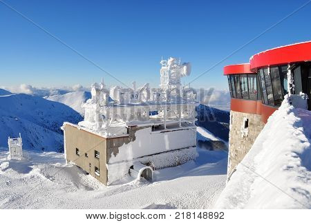 Jasna Slovakia - December 1 2017: View of the peaks of the mountains from the station of the cableway Chopok on a sunny day in the ski resort Jasna Low Tatras Slovakia.