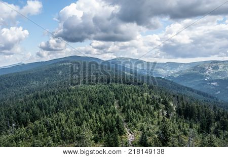 scenery of Kralicky Sneznik mountain range with highest Kralicky Sneznik hill on the midlle and other hills around from view tower on Klepac hill on czech-polish borders