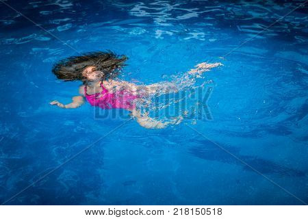 Pool Safety - Young Girl Drowning Struggling to Swim Underwater in Pool