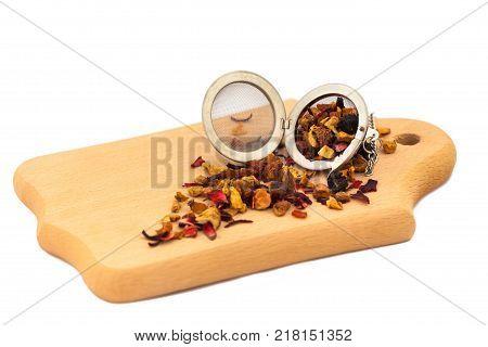 pile of fruit tea black tea green tea herbal tea on the wooden board