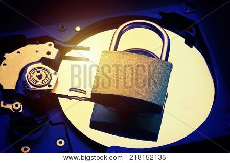 Padlock on computer hard disk drive HDD. Internet data privacy information security concept