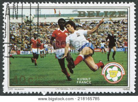 BELIZE-CIRCA 1982: A stamp printed in the Belize is dedicated to FIFA World Cup 1982 in Spain shows a match between Kuwait - France circa 1982