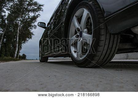 Sports car side view alloy wheels summer