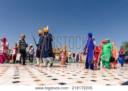 AMRITSAR INDIA - MARCH 21 2016: Sikh people wearing traditional clothes at Sri Harmandir Sahib known as Golden Temple located in Amritsar Punjab India.