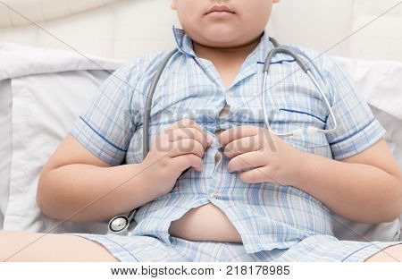 Obese Fat Boy Overweight. Tight Shirt Of Pajamas