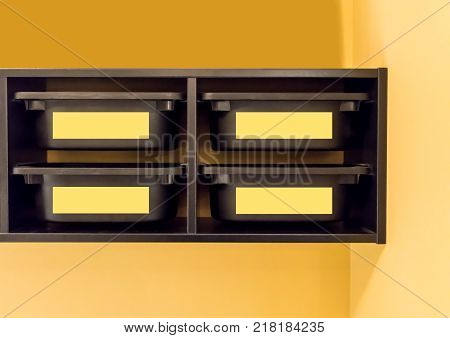 Black Plastic Storage Bin With Yellow Label For Room Organizer