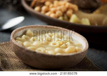 sopa de galets or escudella de Nadal, and carn dolla, soup with galets pasta and the meat and vegetables used in the broth, typically eaten on Christmas in Catalonia, Spain