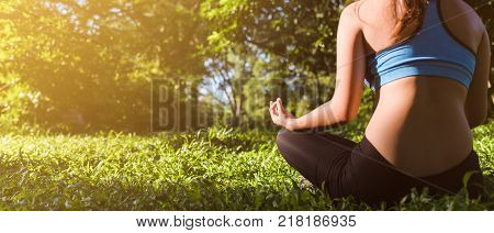 Yoga in the park outdoor with effect light health woman Yoga woman. Concept of healthy lifestyle and relaxation. banner panoramic crop for copy space.  yoga vintage. yoga in park. girl yoga relex. yoga fitness. yoga concept.