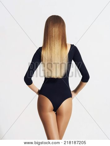 Beautiful and sexy female back. Fit and seductive woman in nylon hosiery.