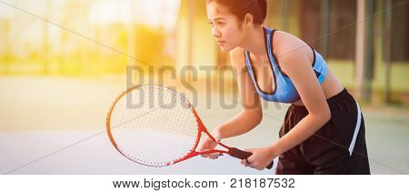 Woman playing tennis and waiting for the service. sunset banner panoramic crop for copy space. tennis on sunset. tennis sport girl. tennis racket. tennis player