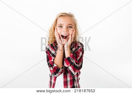 Portrait of a happy little girl holding hands at her face and looking at camera isolated over white background
