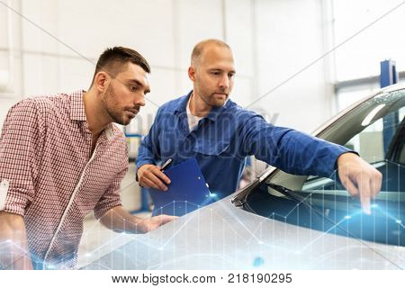 auto service, repair, maintenance and people concept - mechanic checking windshield wiper and man or owner at car shop