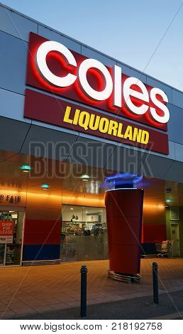 Sydney Australia - November 13 2017: Coles supermarket and Liquorland neon signboards near shop entrance in Edgecliff. Liquorland is an Australian liquor chain a part of the Coles Liquor division.