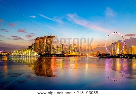 SINGAPORE CITY SINGAPORE: Dec 122017: Singapore Skyline. Singapore`s business district marina bay sand and the garden by the bay on sunset.