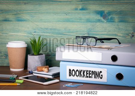bookkeeping concept. Binders on desk in the office. Business background.