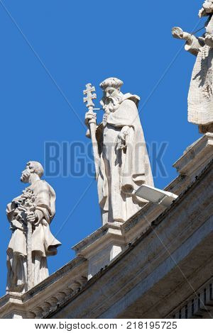 ROME, ITALY - SEPTEMBER 02: St. Joseph, Peter Nolasco and Paul first Hermit, fragment of colonnade of St. Peters Basilica. Papal Basilica of St. Peter in Vatican, Rome, Italy on September 02, 2016.