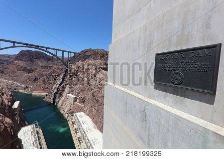 NEVADA, USA - June 30, 2017: Sign at the Hoover Dam. Its located on the street of the Dam in memory of Herbert Clark Hoover,  the 31st President of the United States