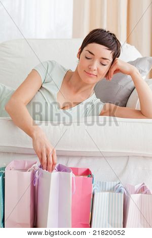 Portrait Of A Lovely Woman Loooking Into Shopping Bags
