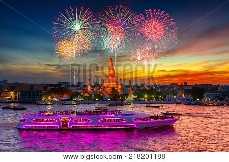 Fireworks at Wat arun and cruise ship in sunset time under new year celebration Bangkok city Thailand