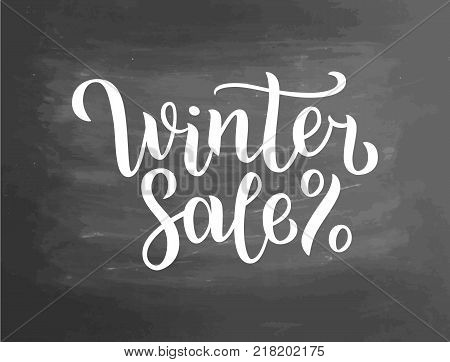 Winter sale lettering on blackboard. Winter sale text lettering for invitation and greeting card, prints and posters. Hand drawn typographic inscriptions. Vector illustration.