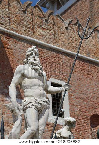 Venice Italy Statue Of Neptune With The Trident Near The Buildin