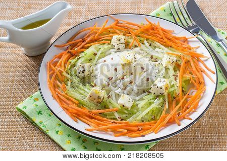 Vitamin salad from carrots daikon and radishes with cheese vinaigrette sauce and flaxseed. Detox products. Prevention of avitaminosis influenza and colds. Vegetarian healthy and diet food