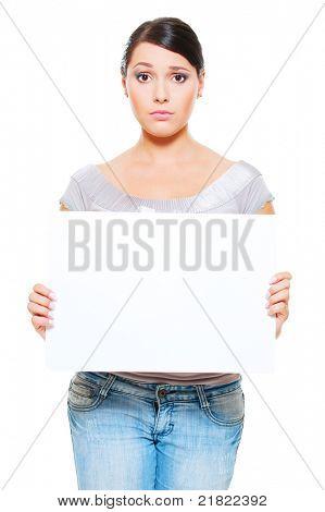 portrait of crestfallen woman holding empty blank against white background