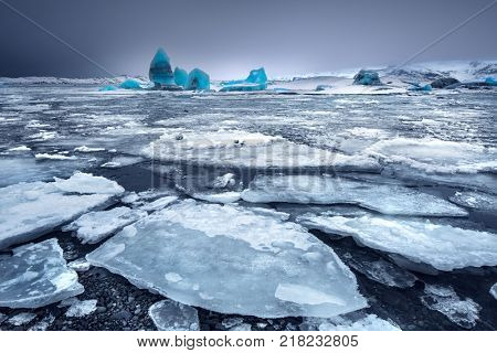 Glacial lake with icebergs, Jokulsarlon is a glacial lagoon, Vatnajokull National Park in southeastern Iceland, blue waters are dotted with icebergs from the Breidamerkurjokull Glacier