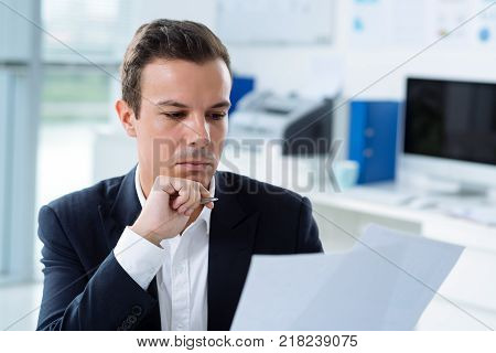 Professional financial analyst reading an important document