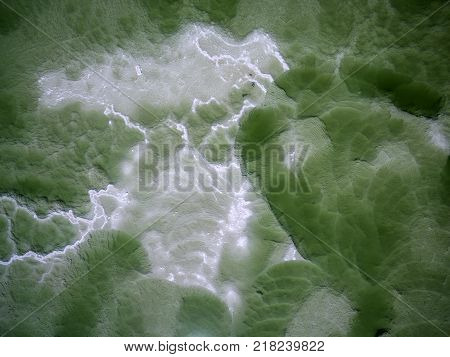 View of Texture of the bottom of Dead sea salt shore coastline in Ein Bokek Israel. nature background