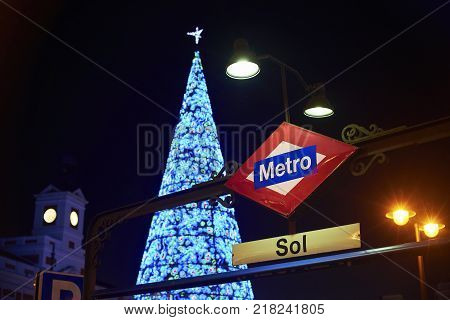Madrid, Spain - December 11, 2017. Nightfall view of Gran Via street illuminated by christmas lights and neon signboards located in central Madrid. View from Callao square.