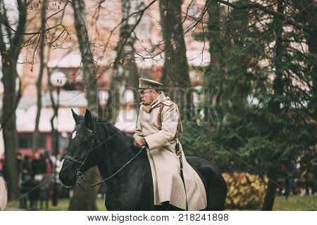 Gomel, Belarus - November 26, 2017: Celebration For The Century Of October Revolution. Reenactor In The Form Of White Guard Soldiers Of Imperial Russian Army Riding Horse.
