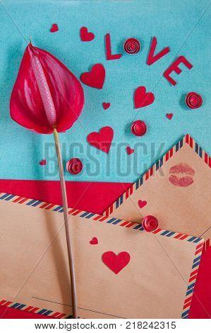 Overhead Flat Lay Saint Valentine Day Background. Scarlet Flower Spathifyllum, Vintage Kraft Envelop