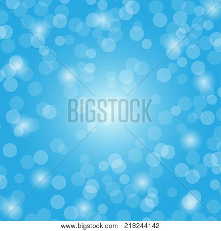 Abstract blue bokeh circles and light on blue background using for Christmas or Happy new year background festive background with defocused light.