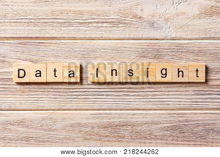 data Insights word written on wood block. data Insights text on table concept.