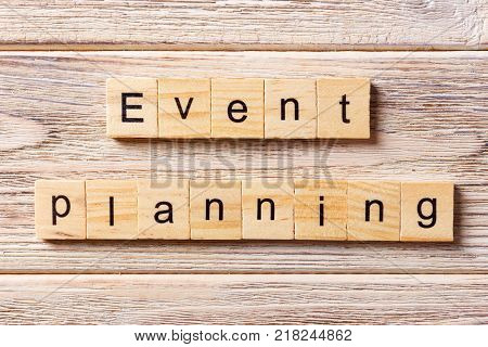 Event planning word written on wood block. Event planning text on table concept.