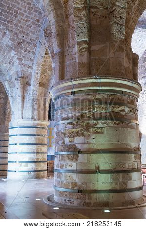 Acre Israel November 03 2017 : Massive pillars supporting the ceiling in the dining room in the ruins of the fortress in the old city of Acre in Israel