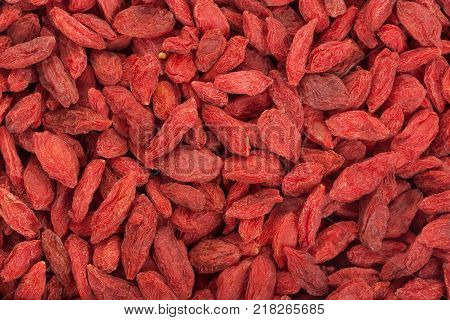 Dried Goji Berries. Background of red ripe goji berries.