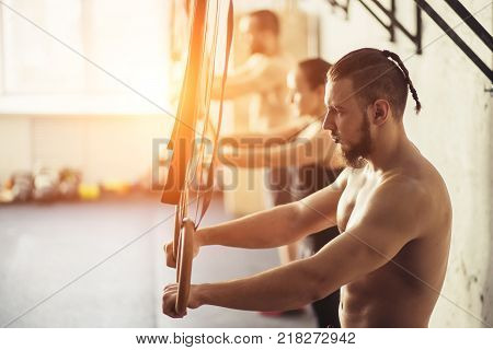 Fitness dip ring man relaxed after workout at gym dipping exercise