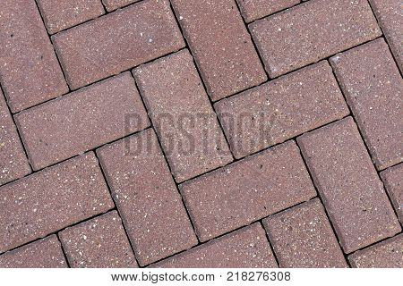 The texture of paving slabs. Pattern of paving slabs on the street
