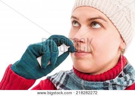 Cold Woman Hand With Gloves Holding Nasal Spray