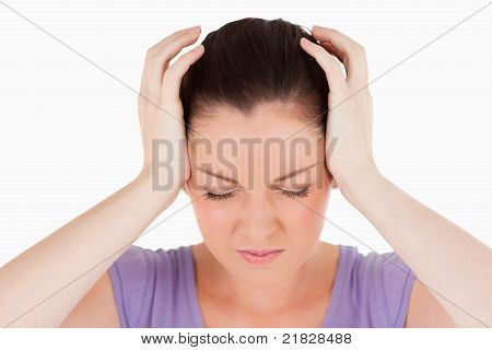 Portrait Of An Attractive Woman Having A Headache While Standing