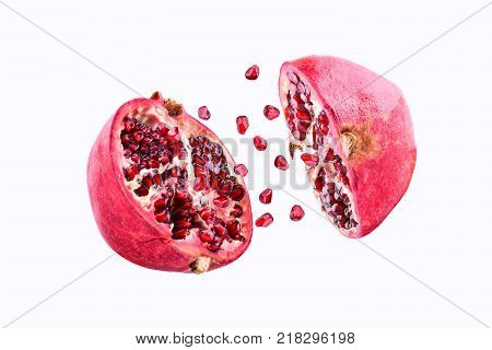 Pomegranate in flight burst on a white background, isolated. Cut half pomegranate flying in the air. Pomegranate fruit explosion.